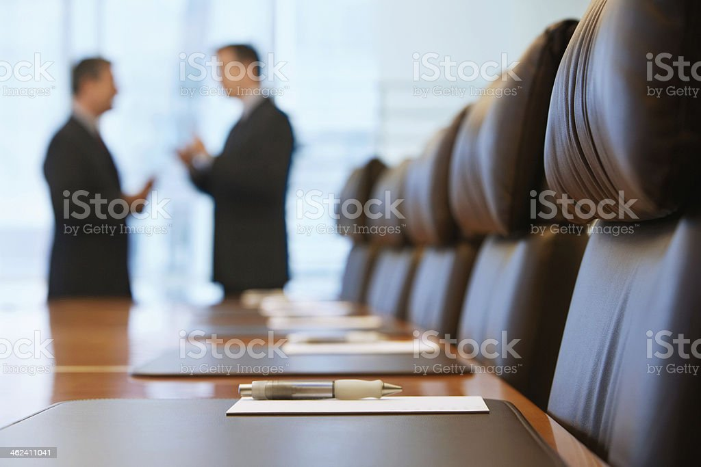 Businessmen Talking In Conference Room stock photo