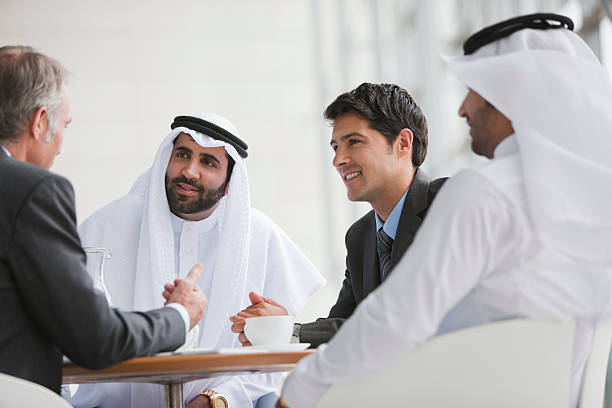 Businessmen talking in meeting stock photo