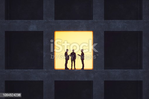 istock Businessmen talking in secrecy 1054524238