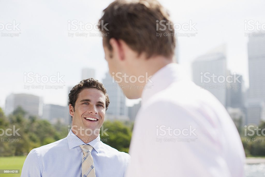 Businessmen talking outdoors royalty-free stock photo