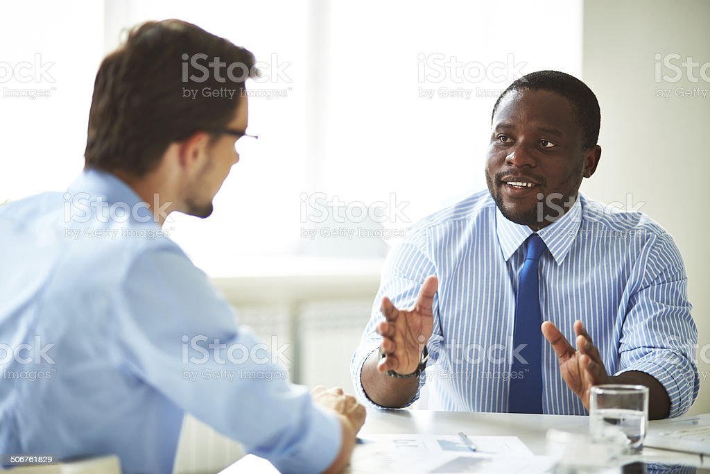 Businessmen talking stock photo