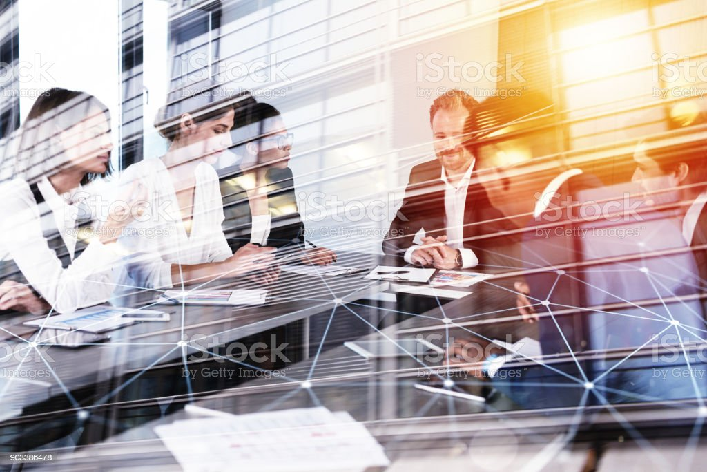 Businessmen that work together in office with network connection effect. Concept of teamwork and partnership. double exposure foto stock royalty-free