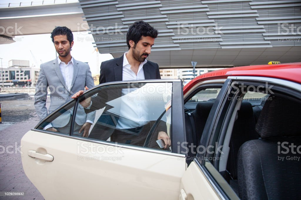Businessmen traveling by taxi stock photo
