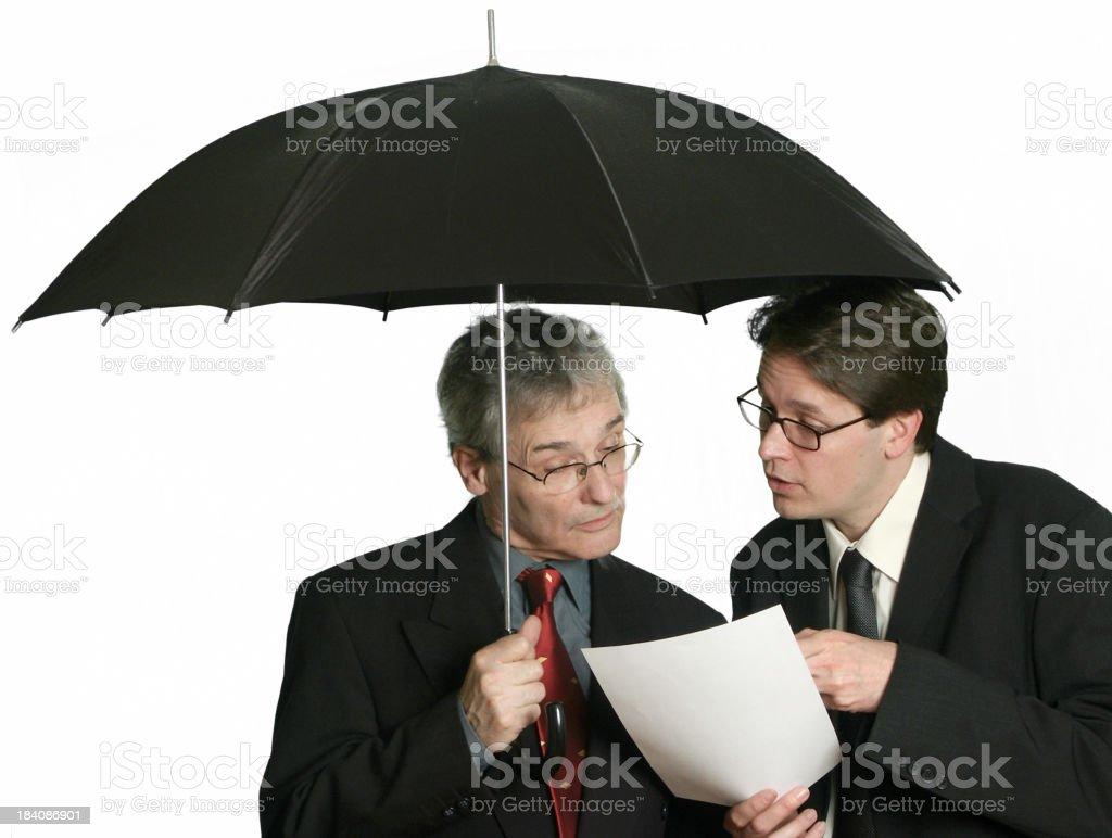 Businessmen under Umbrella royalty-free stock photo