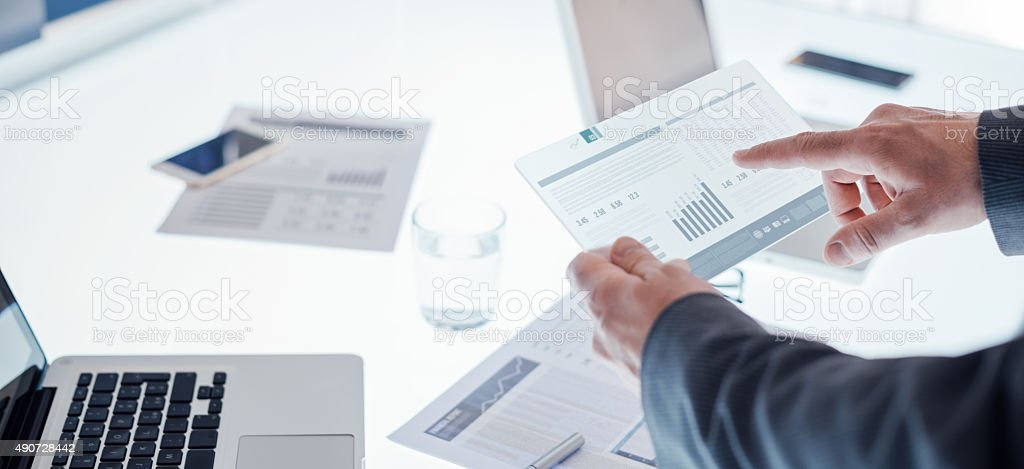 Businessmen using a touch screen device stock photo