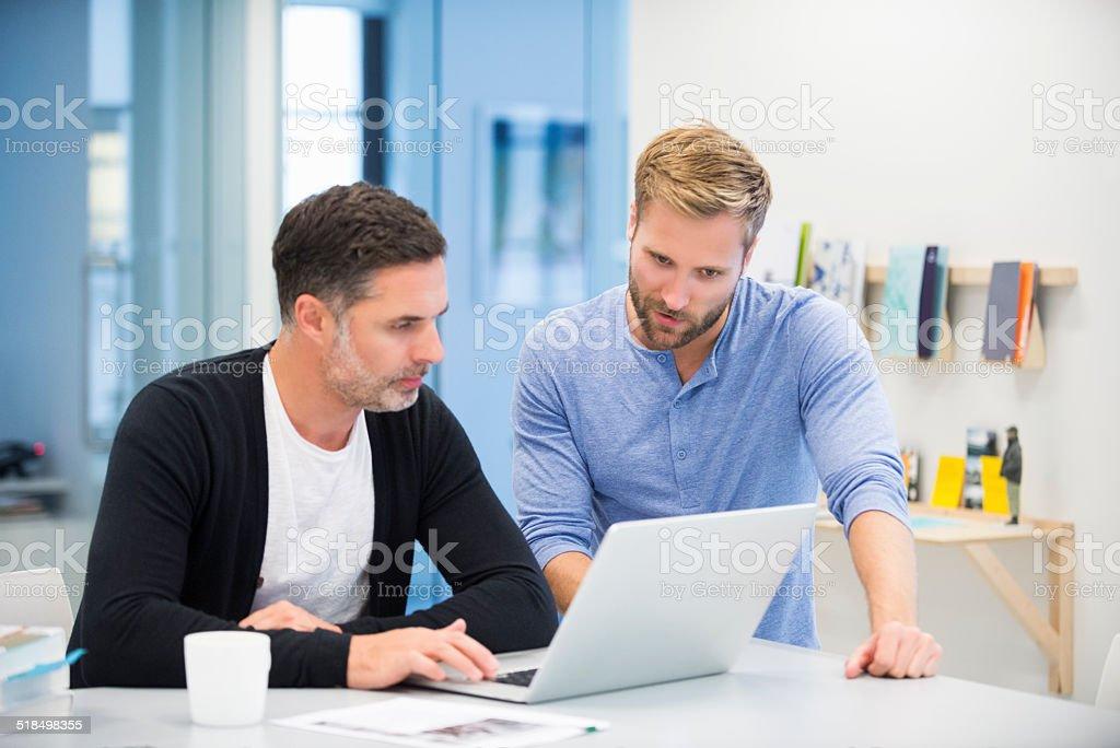 Businessmen using laptop - Royalty-free 30-39 Years Stock Photo
