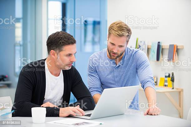 Businessmen Using Laptop Stock Photo - Download Image Now