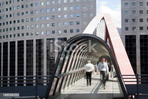 889637894 istock photo Businessmen Walking Along an Elevated Walkway, La Defense, Paris 183056333