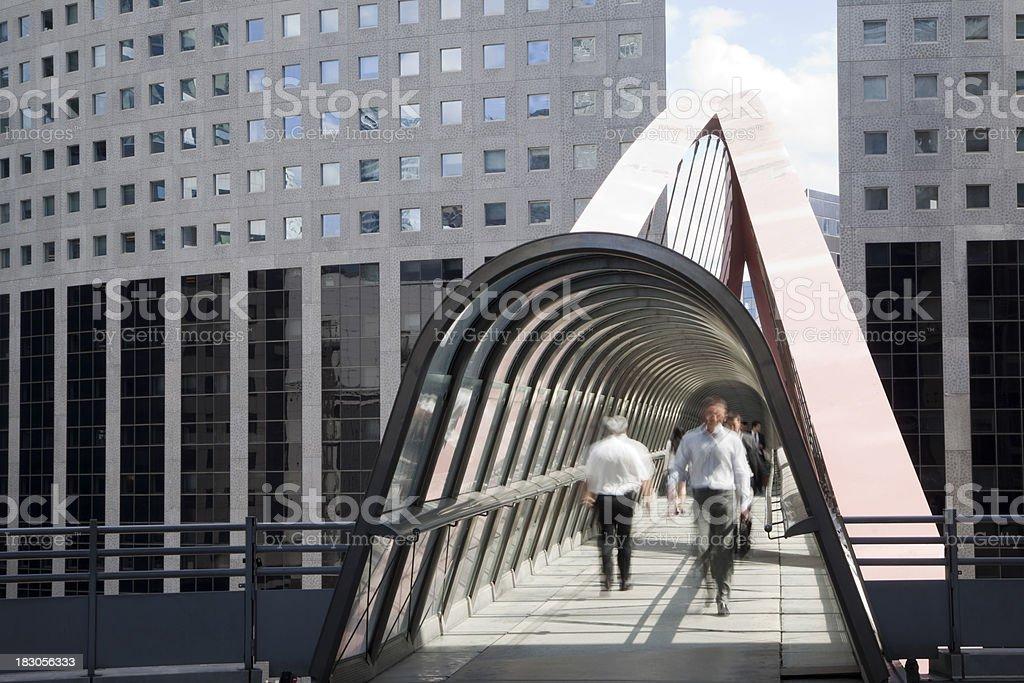 Businessmen Walking Along an Elevated Walkway, La Defense, Paris stock photo