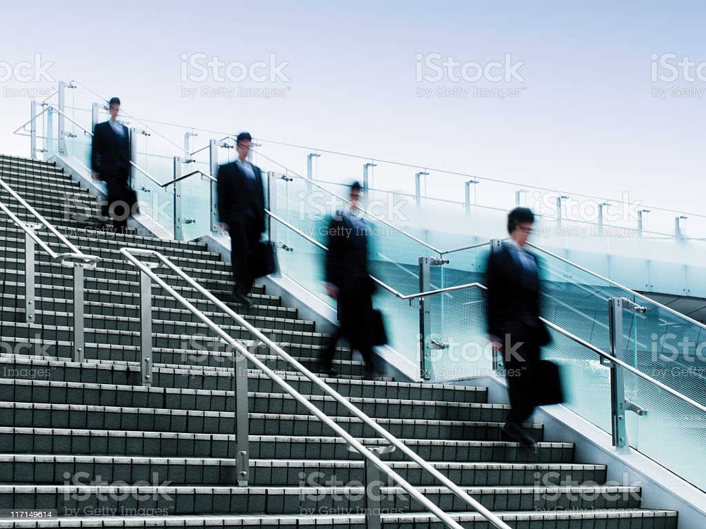 Businessmen Walking Down a Flight of Stairs royalty-free stock photo