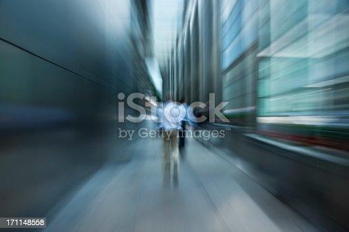 istock Businessmen Walking Down Futuristic Passage in Financial District 171148558