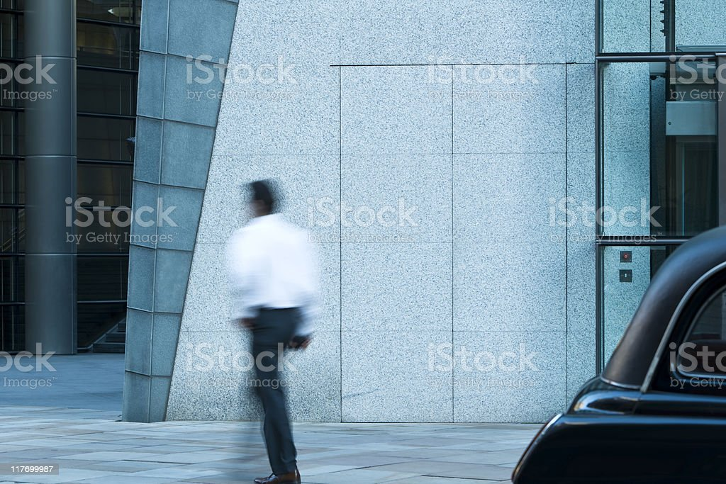Businessmen walking in a London's financial district royalty-free stock photo