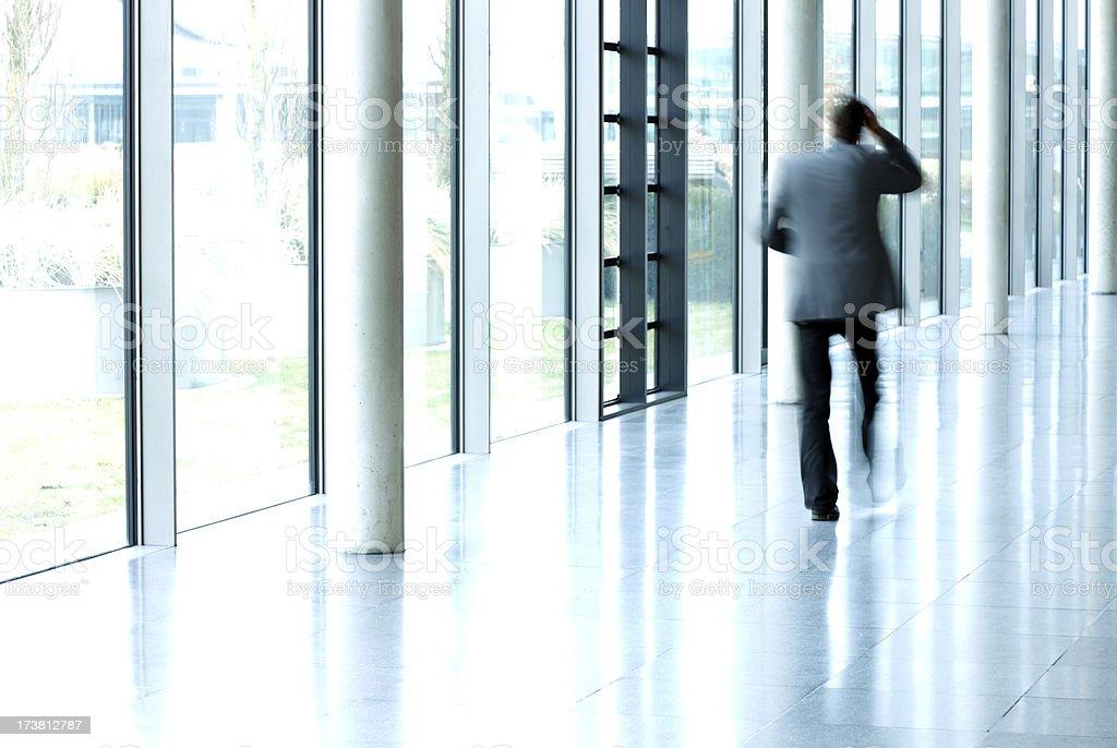 Businessmen Walking in Corridor royalty-free stock photo