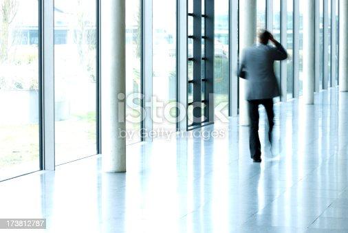 istock Businessmen Walking in Corridor 173812787