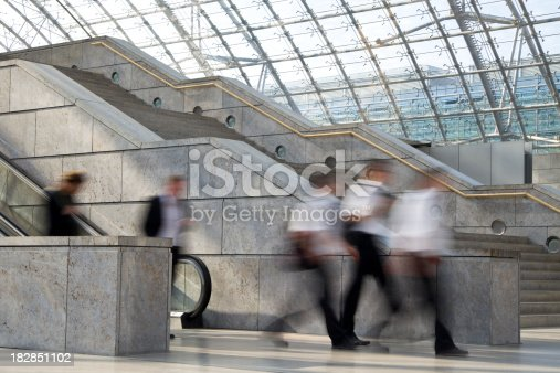 180698194 istock photo Businessmen Walking in Transportation Building with Stairs and Escalators 182851102