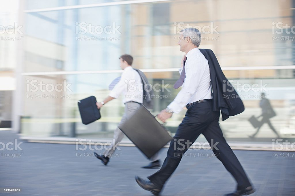 Businessmen walking outdoors royalty-free stock photo