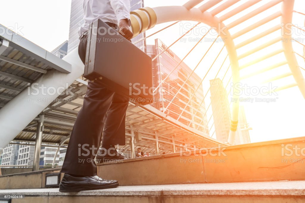 Businessmen walking to work in the morning. stock photo