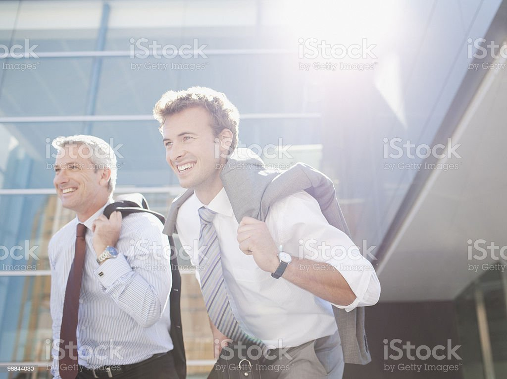 Businessmen walking together outdoors royalty-free stock photo