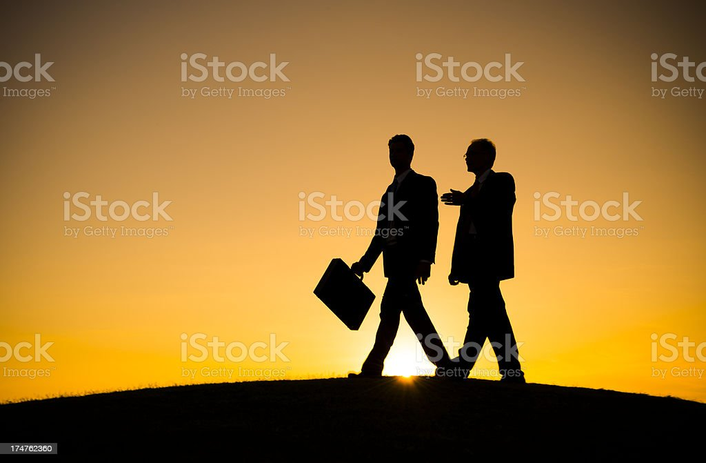 Businessmen walking together royalty-free stock photo