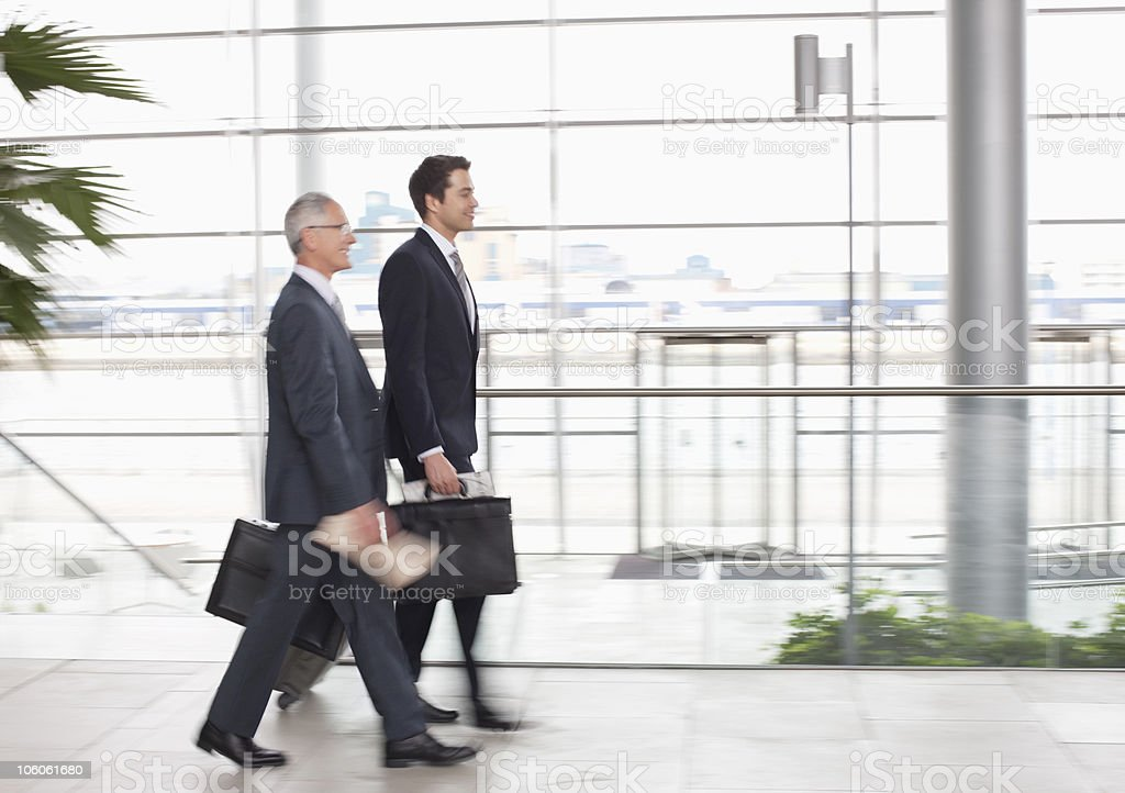 Businessmen walking together with briefcase royalty-free stock photo