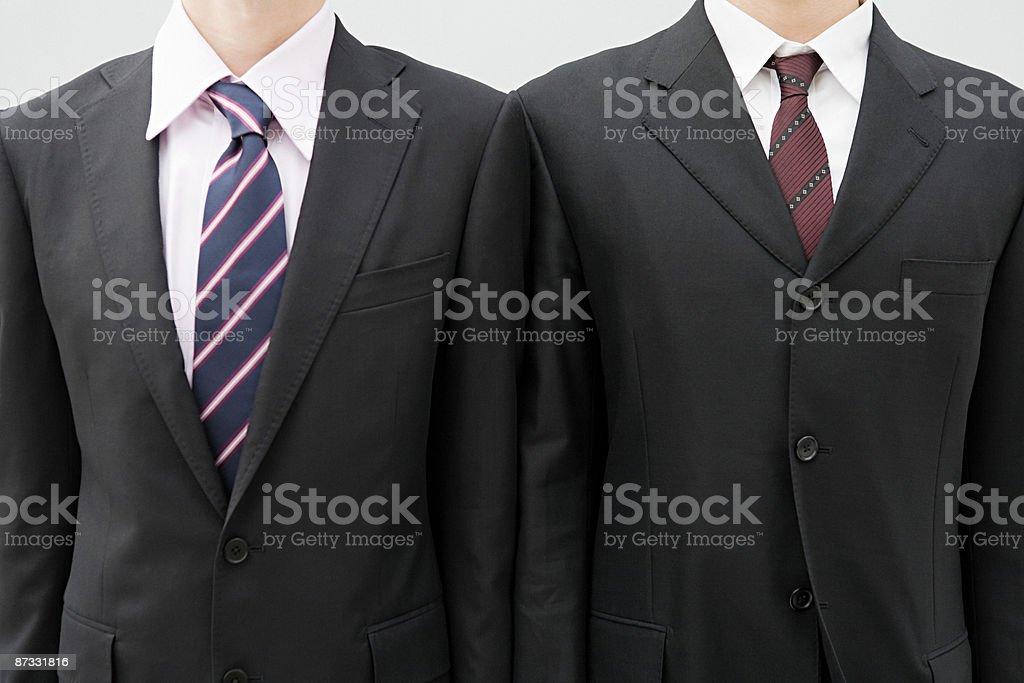 Vestes hommes d'affaires portant Costume photo libre de droits