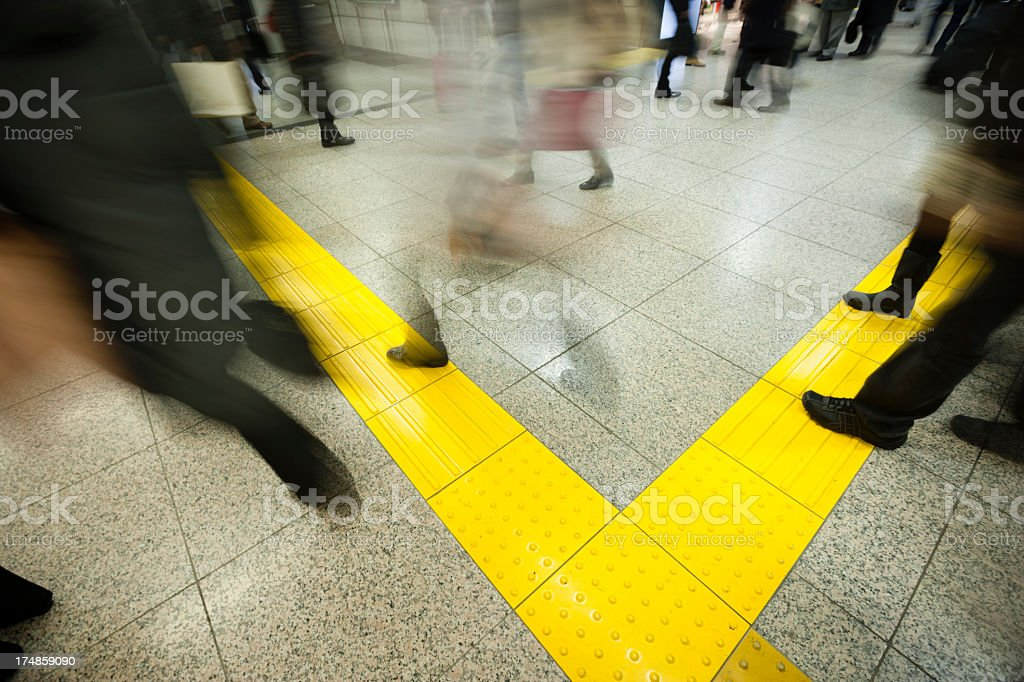 Businessmen who hurry in station royalty-free stock photo