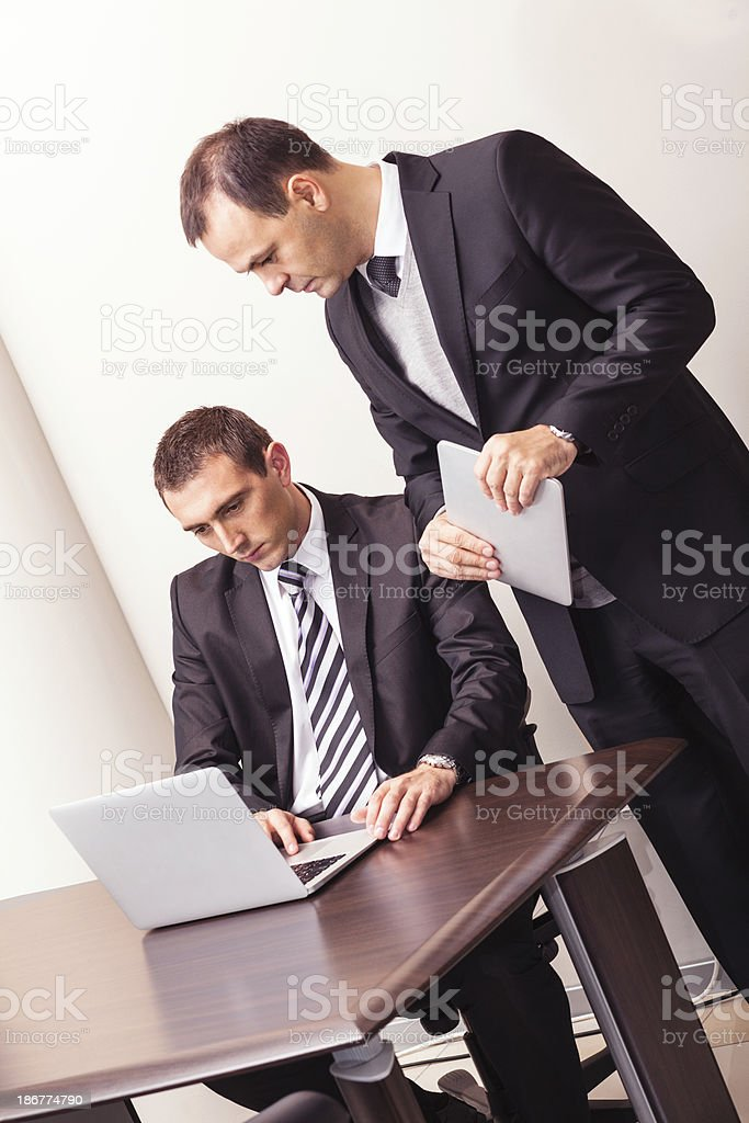 Businessmen with laptop and tablet royalty-free stock photo