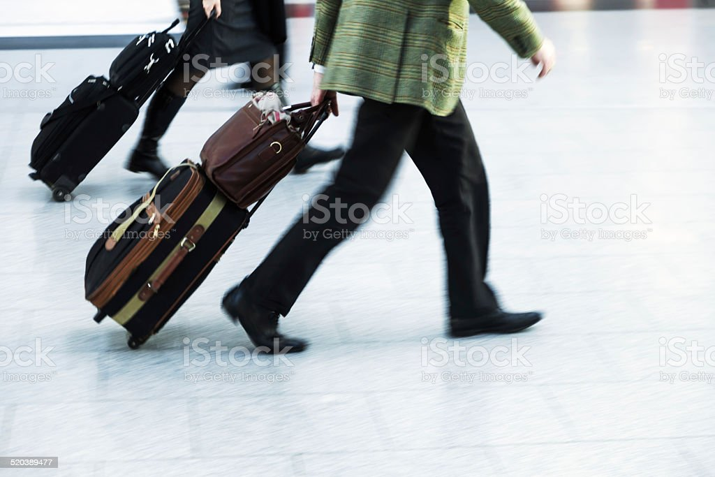 businessmen with trolley bags at the airport stock photo