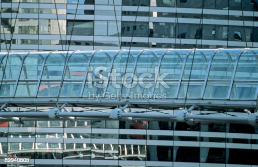 889637894 istock photo Businessmen Wlking on Elevated Glass Walkway in Financial District, Paris 89940805