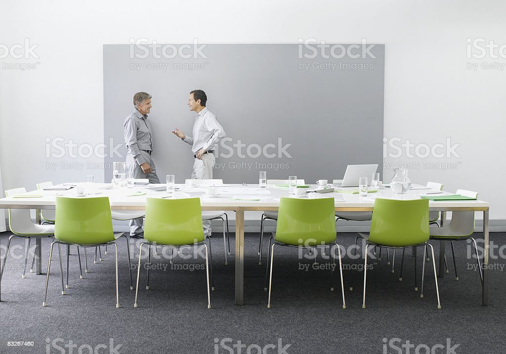 Businessmen working in conference room royalty-free stock photo