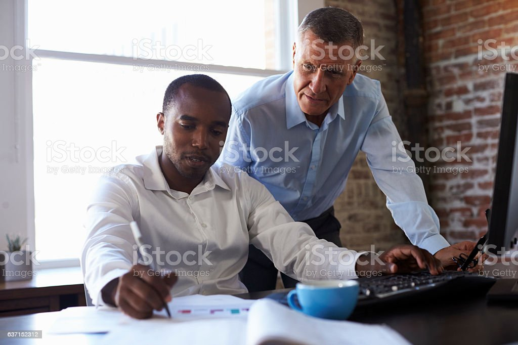 Businessmen Working On Computer In Office stock photo