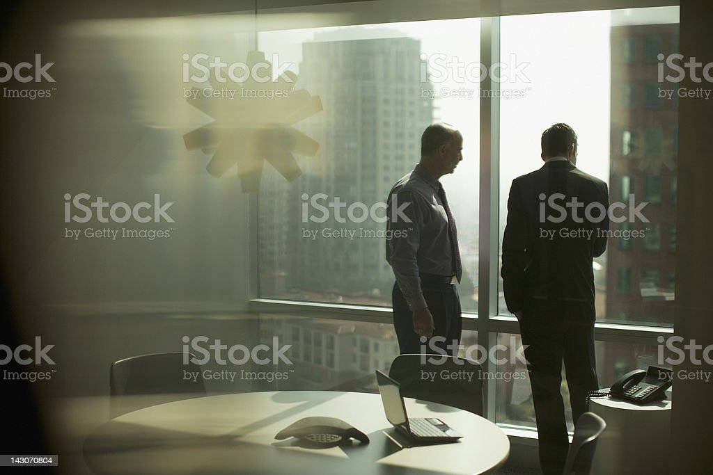 Businessmen working together in office stock photo