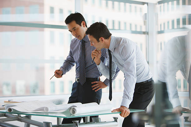 Businessmen working together in office  japanese ethnicity stock pictures, royalty-free photos & images