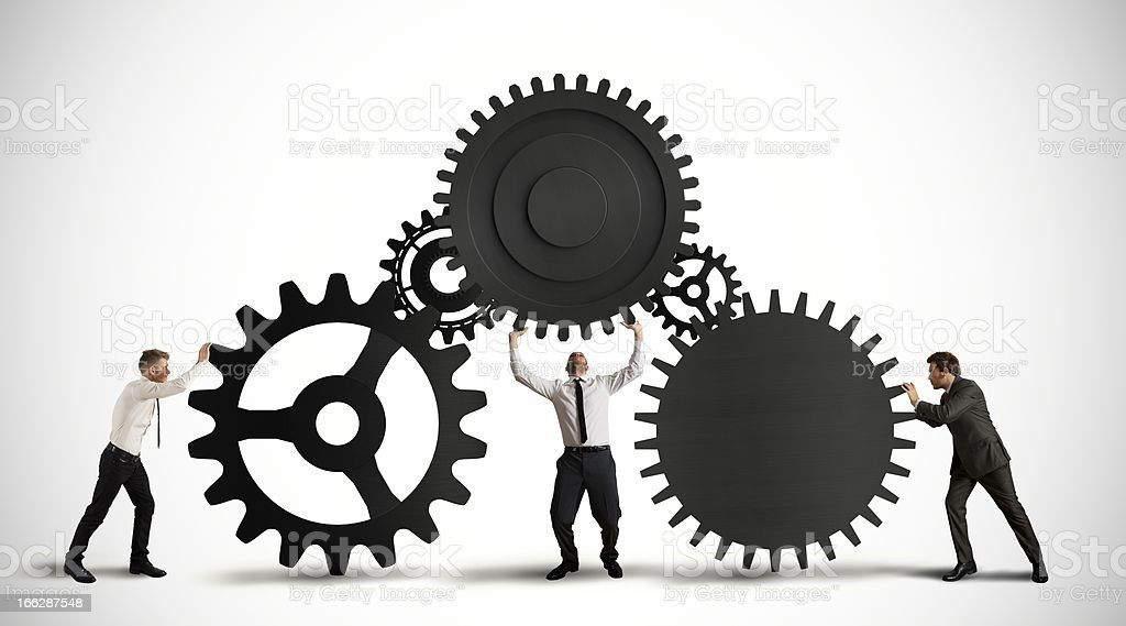A businessmen working together to make things work stock photo