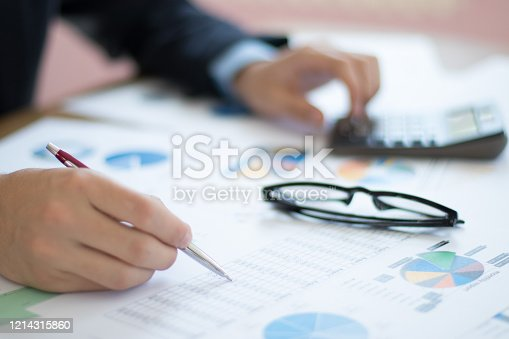 Businessmen working with graph data at home office