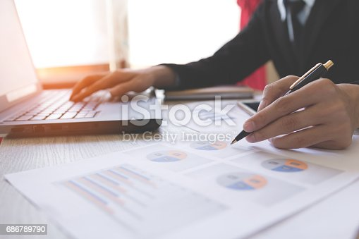 istock Businessmen working with graph data at office,Finance managers task,Concept business and finance 686789790