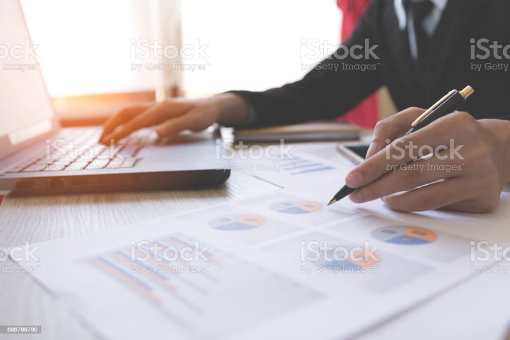 Businessmen working with graph data at office,Finance managers task,Concept business and finance stock photo