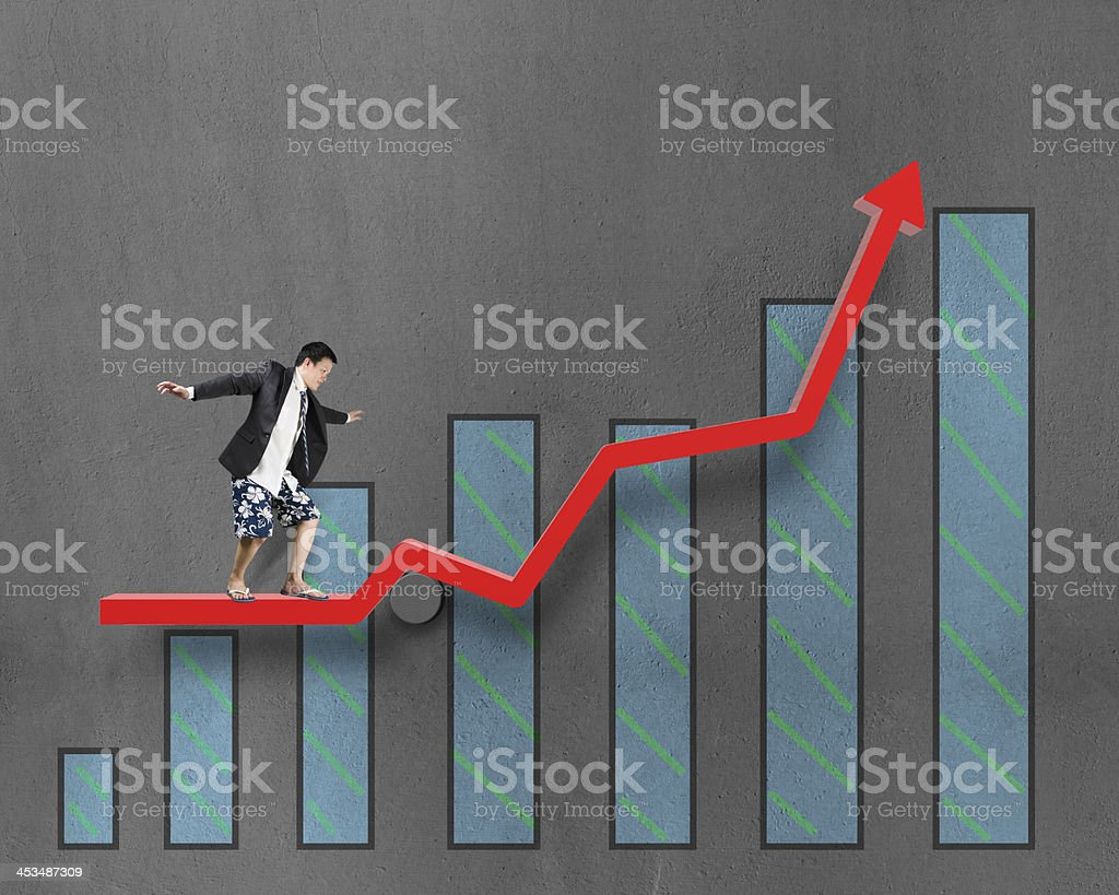 Businessnan surfing on growth red arrow with histogram drawing royalty-free stock photo