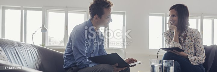 istock Businesspartners in office discussion 1174393939