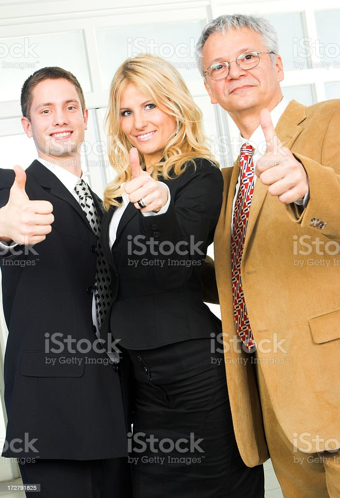 Businesspeople, all ages, thumbs-up royalty-free stock photo