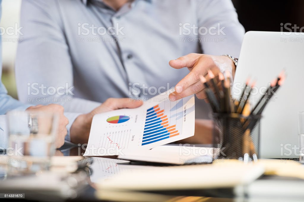 Businesspeople analyzing graphs stock photo