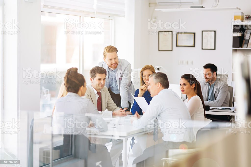 Businesspeople and architects planning stock photo