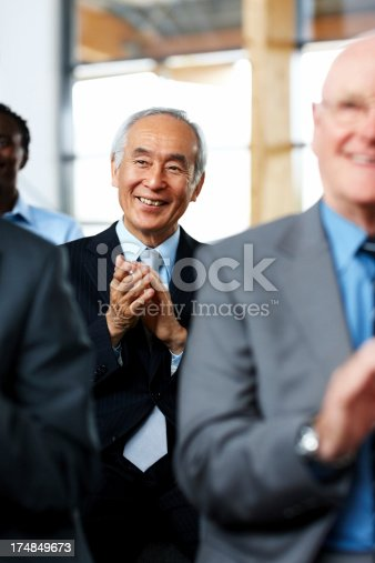 1180918029 istock photo Businesspeople applauding a great presentation 174849673