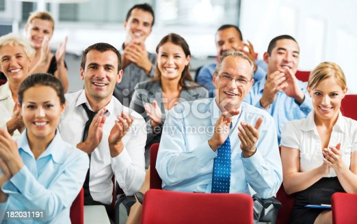 640177838 istock photo Businesspeople applauding during seminar. 182031191