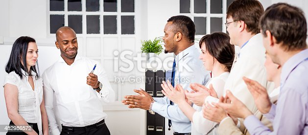istock Businesspeople applauding for new boss 482986572