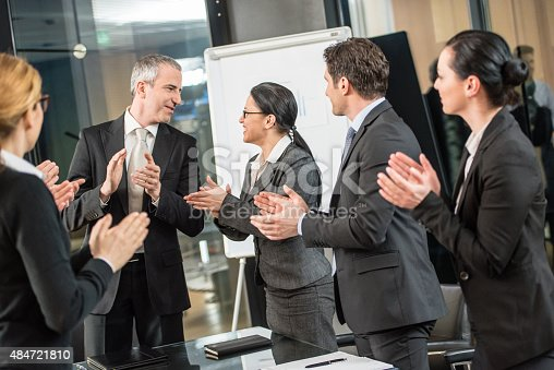istock Businesspeople applauding in conference room 484721810