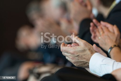 511305456 istock photo Businesspeople applauding 187696061