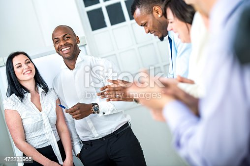 511305456 istock photo Businesspeople applauding 472233955