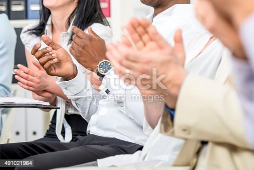 511305456 istock photo Businesspeople Applauding 491021964