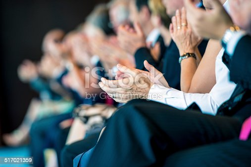511305456 istock photo Businesspeople applauding 517021359